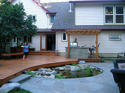 Nyce Gardens Expanded The Space By Drawing The Deck Outward To A Dining Area  With A New Outdoor Covered Cooking Area And Reflecting Pond Surrounded By A  ...